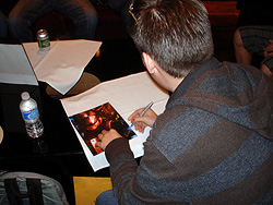 Jeff Jenkins signing a copy of his print