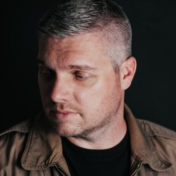 Headshot of Matt Brett taken in 2020